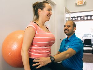 Physio Therapist Working on Poor Posture Among Students   Surrey 152St Physiotherapy & Sports Injury Clinic