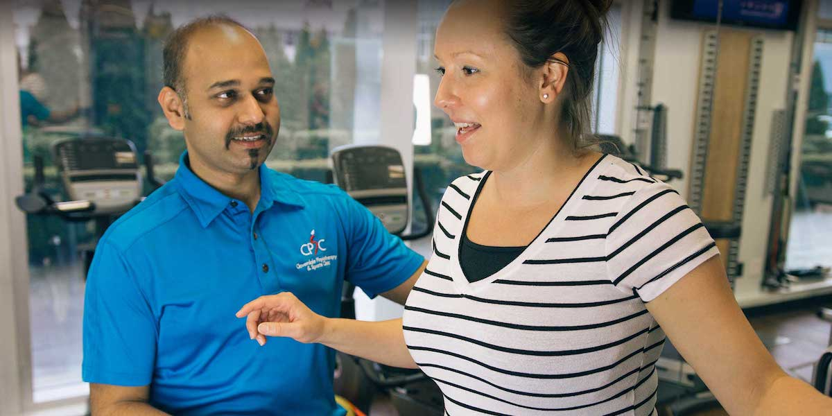 Working on a Back Pain Injuries With Physiotherapist in Surrey, BC | Surrey 152St Physiotherapy & Sports Injury Clinic